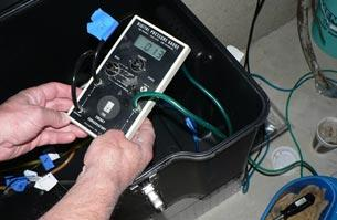 two hands operating a micromanometer